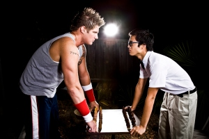 Geek and body builder playing chess
